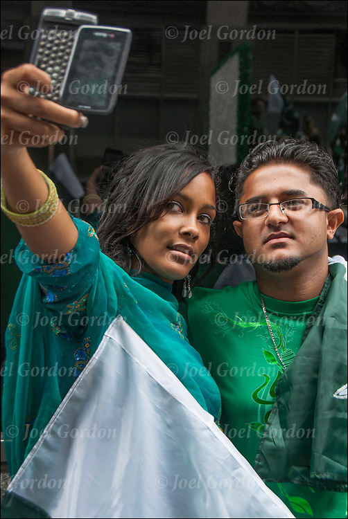 American India teenage couple taking selfie at the India Day Parade in New York City<br />