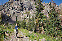 A man hikes along the trail to South Colony Lakes in the Sangre de Cristo mountain range near Westcliffe, Colorado. Model: Jessie Coffman