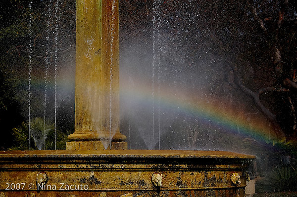 Rainbow forms in Beverly Hills fountain located at the intersection of of Wilshire and Santa Monica Blvds.