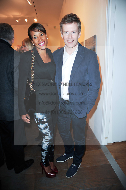 PATRICK KIELTY and THANDI OJEER at a private view of 'Life Vividly Lived Part 1' an exhibition of works inspired by Inishturkbeg, an island off the west coast of Ireland held at Flowers, 21 Cork Street, London on 9th February 2010.