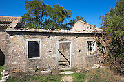 Derelict house ruins in ancient village of Old Perithia - Palea Peritheia - Northern Corfu, Greece