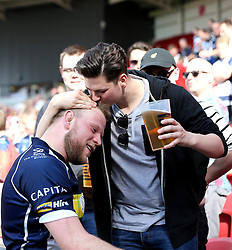 Joe Joyce replacement for Bristol Rugby celebrates the win over Bedford Blues with a fan - Mandatory by-line: Robbie Stephenson/JMP - 08/05/2016 - RUGBY - Ashton Gate Stadium - Bristol, England - Bristol Rugby v Bedford Blues - Greene King IPA Championship Semi-Final Second Leg