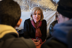 © London News Pictures. Calais, France. 04/03/16. Actress Juliet Stevenson talks with four unaccompanied Syrian boys who live in the Calais 'Jungle' camp and have family in Britain. They are the first celebrities to join the Citizens UK and Help Refugees 'buddy scheme' which aims to put pressure on the British government to allow unaccompanied minors in the Calais 'Jungle' to be reunited with their families in the United Kingdom.  Photo credit: Rob Pinney/LNP