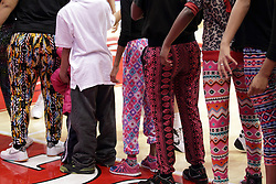 21 December 2015: Tights of all colors and designs are worn y young fans standing line line ready to great the Redbirds. Illinois State University Women's Basketball team hosted The Cougars of Chicago State at Redbird Arena in Normal Illinois.