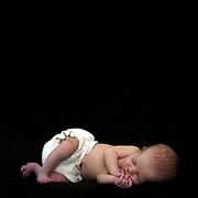 A studio portrait of a newborn baby girl. Photo Tim Clayton