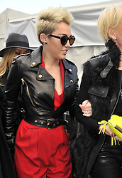 (UK RIGHTS ONLY) Miley Cyrus wearing a black leather bikers jacket, red suit leaving a fashion show in New York, USA. 13/02/2013<br />BYLINE MUST READ : EAGLEPRESS/GOTCHA IMAGES<br /><br />Copyright by © Gotcha Images Ltd. All rights reserved.<br />Usage of this image is conditional upon the acceptance <br />of Gotcha Images Ltd, terms and conditions available at<br />www.gotchaimages.com