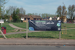 NHS & HM Government Coronavirus information sign in residential area of Reading during lockdown, UK April 2020