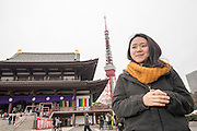 A young Japanese lady with Tokyo Tower in the background.