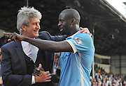 Manuel Pellegrini and Yaya Toure are all smiles after the Barclays Premier League match between Crystal Palace and Manchester City at Selhurst Park, London, England on 12 September 2015. Photo by Michael Hulf.