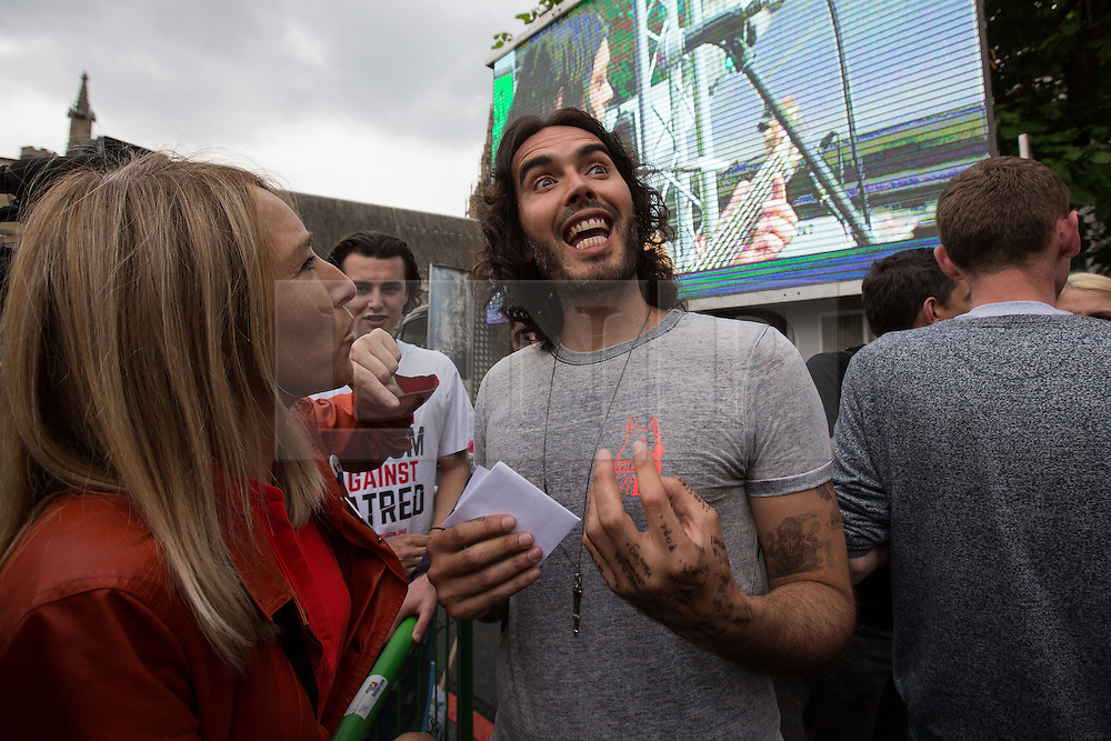 © Licensed to London News Pictures . 20/06/2015 . London , UK . RUSSELL BRAND speaking in Parliament Square . Tens of thousands of people march from the Bank of England to Parliament , to protest economic austerity in Britain . Photo credit: Joel Goodman/LNP