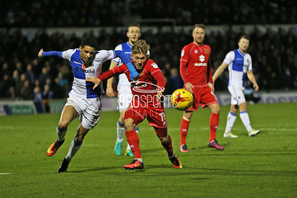 MK Dons George C Williams right (11) battles for the ball with Bristol Rovers Daniel Leadbitter left  (2) second half 0-0 during the EFL Sky Bet League 1 match between Bristol Rovers and Milton Keynes Dons at the Memorial Stadium, Bristol, England on 19 November 2016. Photo by Gary Learmonth.