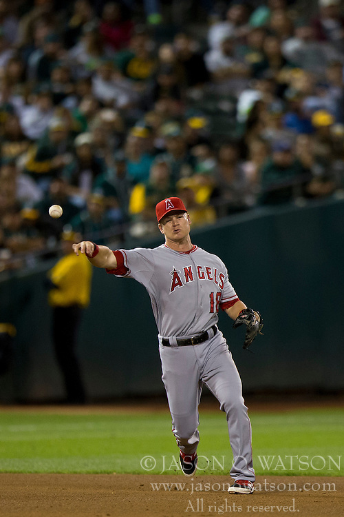 OAKLAND, CA - SEPTEMBER 23:  Gordon Beckham #18 of the Los Angeles Angels of Anaheim throws to first base against the Oakland Athletics during the fifth inning at O.co Coliseum on September 23, 2014 in Oakland, California. The Los Angeles Angels of Anaheim defeated the Oakland Athletics 2-0.  (Photo by Jason O. Watson/Getty Images) *** Local Caption *** Gordon Beckham