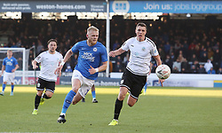 Frazer Blake-Tracy of Peterborough United in action with Paul Rooney of Dover Athletic - Mandatory by-line: Joe Dent/JMP - 01/12/2019 - FOOTBALL - Weston Homes Stadium - Peterborough, England - Peterborough United v Dover Athletic - Emirates FA Cup second round