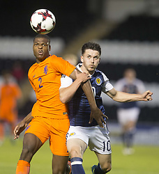 Scotland's Lewis Morgan and Holland's Denzil Dumfries battle for the ball during the 2019 UEFA Euro U21 Qualifying match at the St Mirren Park, Paisley.