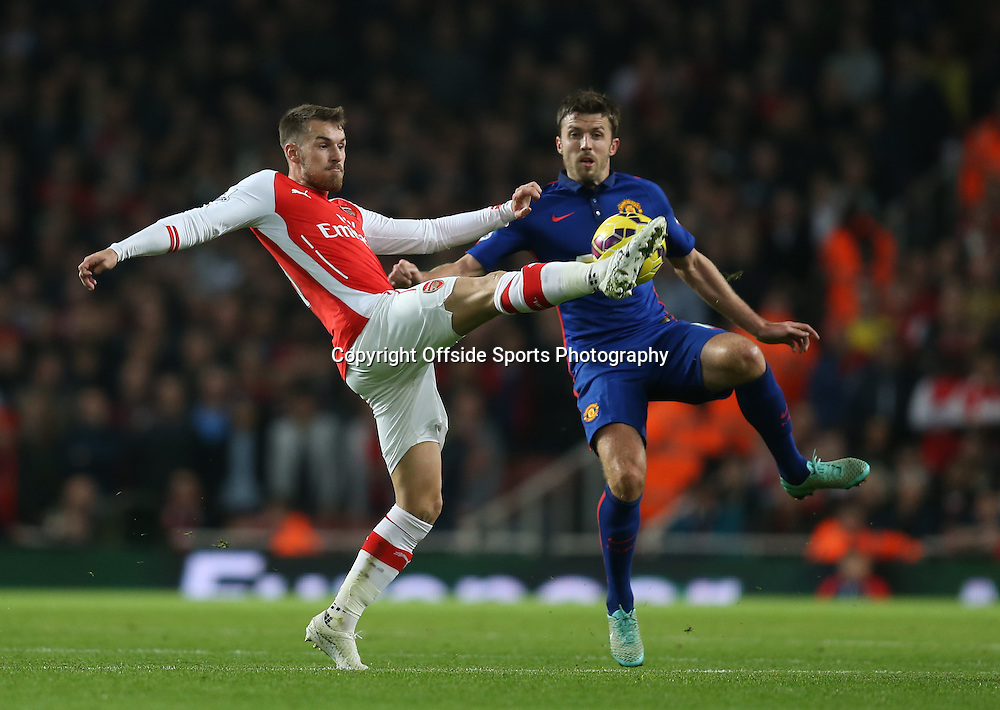 22 November 2014 - Barclays Premier League - Arsenal v Manchester United - Aaron Ramsey of Arsenal in action with Michael Carrick of Manchester United - Photo: Marc Atkins / Offside.