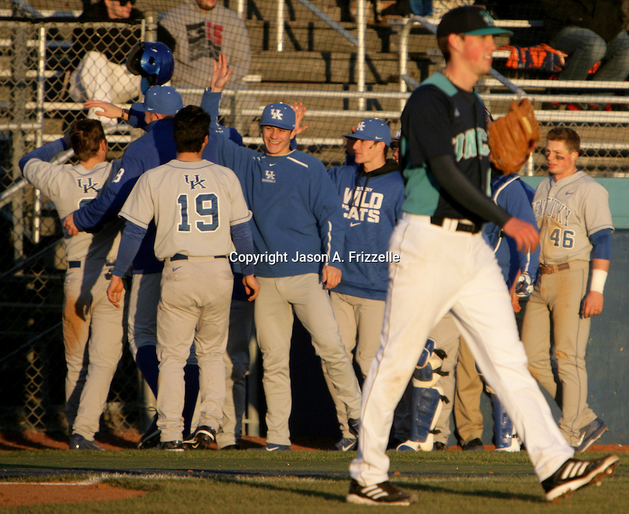 Members of the University of Kentucky Baseball team celebrate a run scored as University of North Carolina at Wilmington's Jordan Ramsey walks back to the mound Saturday February 15, 2014 during the second day of the Hughes Brothers Challenge at Brooks Field in Wilmington, N.C. The University of Kentucky faced the University of North Carolina at Wilmington on the second day of the Hughes Brothers Challenge Saturday February 15, 2014 at Brooks Field on the campus of the University of North Carolina at Wilmington in Wilmington, N.C. (Jason A. Frizzelle)