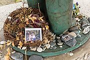 Mementos of those lost at sea placed at the foot of the Seafarers Memorial along Homer Spit on Kamishak Bay in Homer, Alaska.