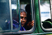 Woman bus passenger, Calcutta, India