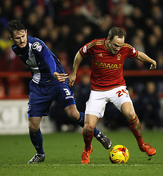 Jonathan Grounds of Birmingham City (L) and David Vaughan of Nottingham Forest in action - Mandatory byline: Jack Phillips/JMP - 12/01/2016 - FOOTBALL - The City Ground - Nottingham, England - Nottingham Forest v Birmingham City -