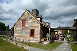 Group of people standing outside of the Kitchen building, Grand Portage National Monument, Grand Portage, Minnesota, United States of America