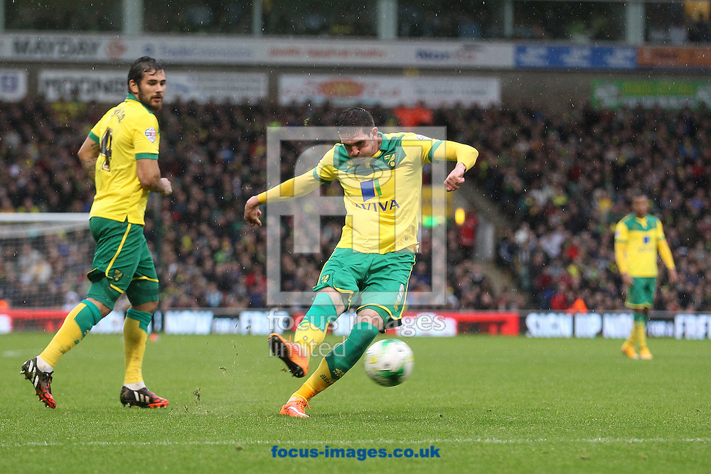 Kyle Lafferty of Norwich hits the post from a free kick and Cameron Jerome of Norwich puts in the rebound for the equalising goal but is injured in the process and doesn't celebrate during the Sky Bet Championship match at Carrow Road, Norwich<br /> Picture by Paul Chesterton/Focus Images Ltd +44 7904 640267<br /> 04/10/2014