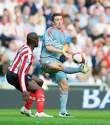 SUNDERLAND, ENGLAND - Saturday, August 16, 2008: Liverpool's Robbie Keane and Sunderland's Nyron Nosworthy during the opening Premiership match of the season at the Stadium of Light. (Photo by David Rawcliffe/Propaganda)