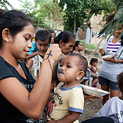 A mom is feeding her child rice mixed with meat at a Mother Support Group session where breast feeding mothers with 4 months plus babies learn about food supplements.Infant mortality rates are very high in Timor-Leste and one of the reasons for that is poor nutrition. Alola advocate breast feeding till at least two years old and teach women about nutritious supplements such as boiled and mashed rice w vegetables and eggs.  Fundasaun Alola is a not for profit non government organization operating in Timor Leste to improve the lives of women and children. Founded in 2001 by the then First Lady, Ms Kirsty Sword Gusmao, the organization seeks to nurture women leaders and advocate for the rights of women.