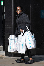 © Licensed to London News Pictures. 15/06/2020. Manchester, UK. A woman carries bags of shopping from Primark . High street shops reopen in Manchester City Centre for the first time since measures forced non-essential retailers to close , in order to limit the spread of the Coronavirus . Photo credit: Joel Goodman/LNP