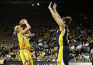 26 JANUARY 2009: Iowa guard Kamille Wahlin (2) puts up a shot over Michigan forward Carly Benson (21) during the first half of an NCAA women's college basketball game Monday, Jan. 26, 2009, at Carver-Hawkeye Arena in Iowa City, Iowa. Iowa defeated Michigan 77-69.