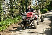 Man driving quad bike, Island of Herm, Channel Islands, Great Britain