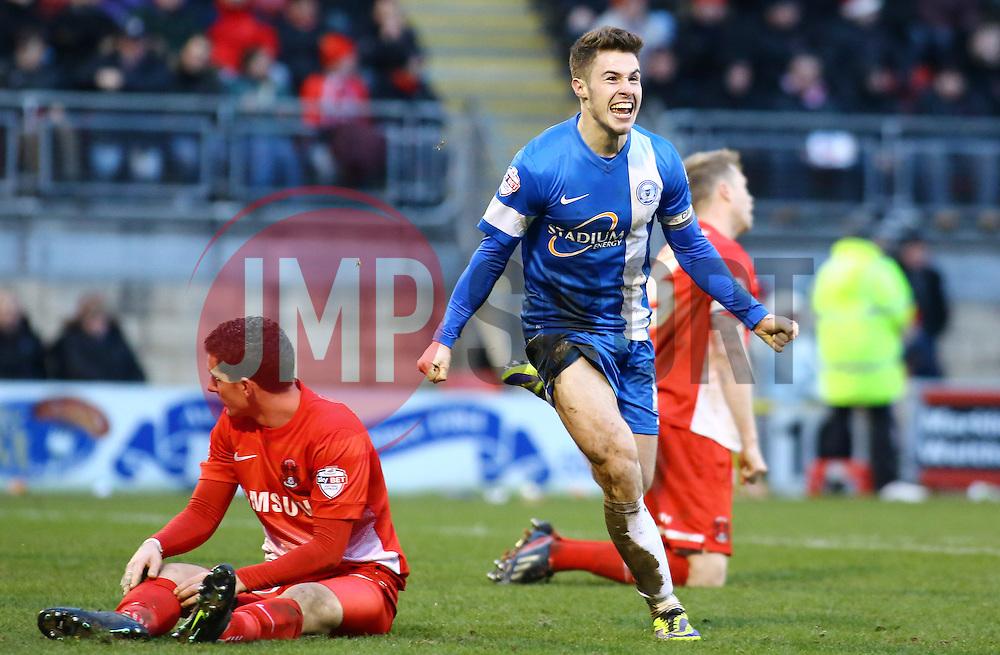Peterborough United's Tommy Rowe celebrates scoring the winning goal - Photo mandatory by-line: Joe Dent/JMP - Tel: Mobile: 07966 386802 08/02/2014 - SPORT - FOOTBALL - Leyton - Brisbane Road - Leyton Orient v Peterborough United - Sky Bet League One