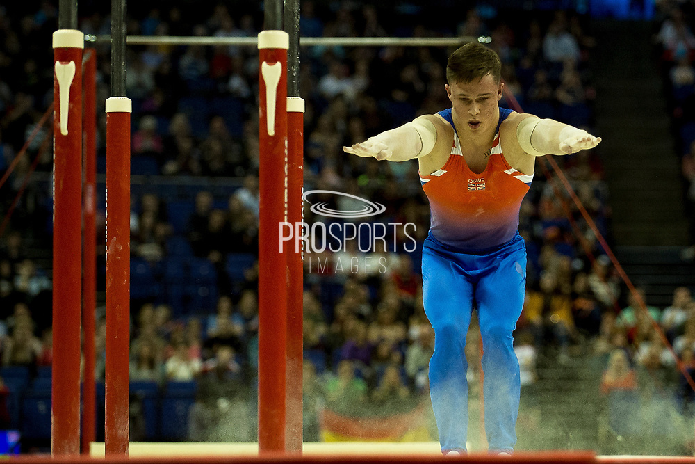 Brinn Bevan of Great Britain (GBR) dismounts from the Parallel bars during the iPro Sport World Cup of Gymnastics 2017 at the O2 Arena, London, United Kingdom on 8 April 2017. Photo by Martin Cole.