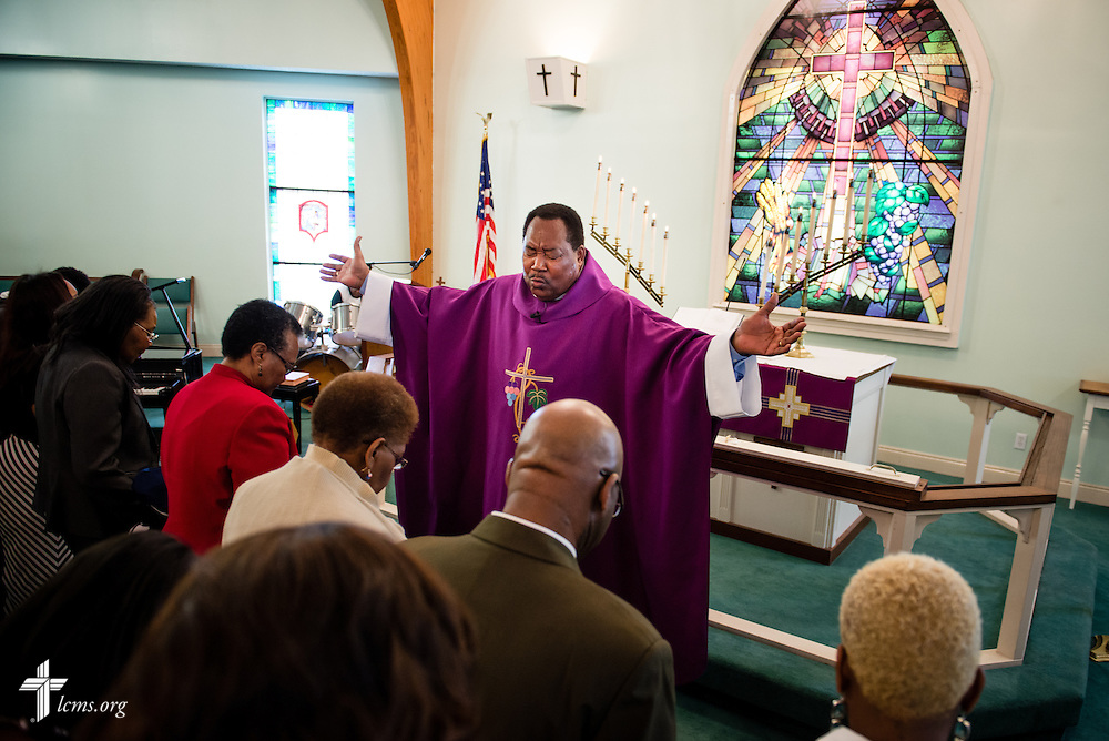 The Rev. Ulmer Marshall prays with parishioners during worship at Trinity Lutheran Church on Sunday, April 6, 2014, in Mobile, Ala. LCMS Communications/Erik M. Lunsford