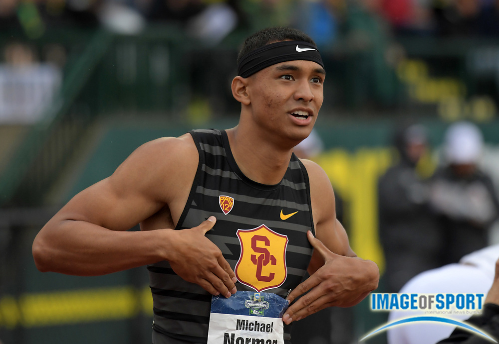 Jun 8, 2018; Eugene, OR, USA; Michael Norman of Southern California poses after winning the 400m in a collegiate record 43.61 during the NCAA Track and Field championships at Hayward Field.