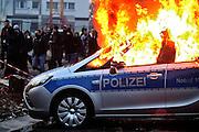 Frankfurt am Main | 18 Mar 2015<br /> <br /> Blockupy-Proteste in Frankfurt am 18.03.2015, hier: Am fr&uuml;hen Morgen brennt in der Hanauer Landstrasse ein Polizeiauto.<br /> <br /> photo &copy; peter-juelich.com