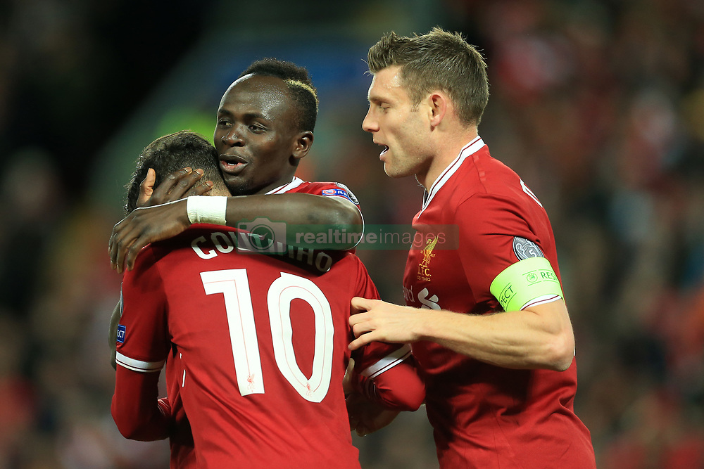 6th December 2017 - UEFA Champions League - Group E - Liverpool v Spartak Moscow - Philippe Coutinho of Liverpool celebrates with teammates Sadio Mane (C) and James Milner (R) after scoring their 5th goal - Photo: Simon Stacpoole / Offside.