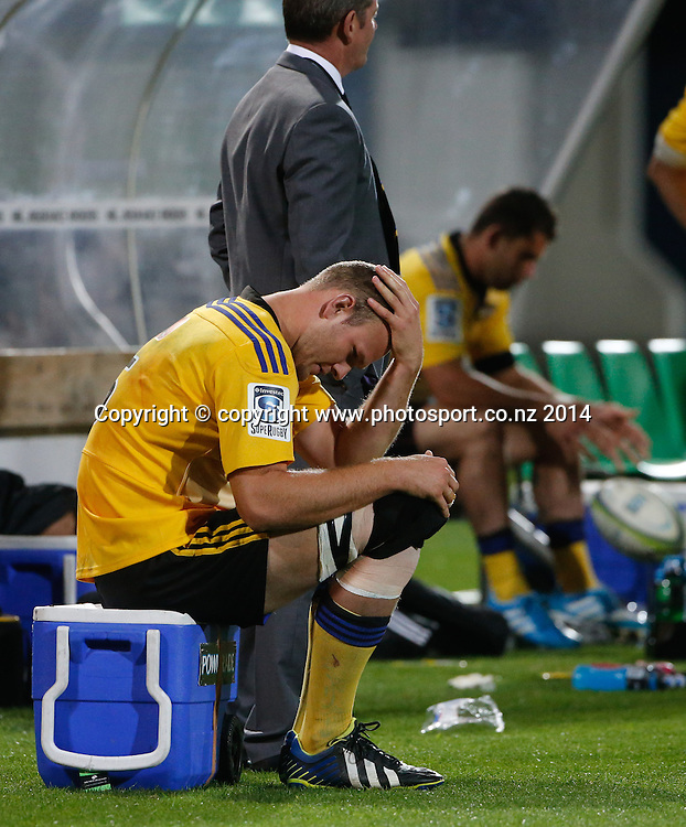 Hurrican's James Broadhurst sits injured on the benchduring the Super Rugby match, Hurricanes v Bulls, McLean Park, Napier, New Zealand. Saturday, 05 April, 2014. Photo: John Cowpland / photosport.co.nz
