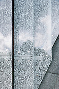Detail showing glass cladding with Yiddish alphabet.