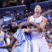 15 April 2014: Denver Nuggets forward Kenneth Faried (35) vies for the rebound with Los Angeles Clippers forward Blake Griffin (32) during the Los Angeles Clippers 117-105 victory over the Denver Nuggets at the Staples Center, Los Angeles, California, USA.