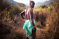 A Samburu warrior guides a group of travelers on a walking safari through the mountains of the Matthews Range, Kenya.