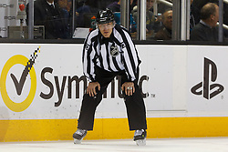 Dec 21, 2011; San Jose, CA, USA; NHL linesman Vaughan Rody (73) before a face off between the San Jose Sharks and the Tampa Bay Lightning during the second period at HP Pavilion. San Jose defeated Tampa Bay 7-2. Mandatory Credit: Jason O. Watson-US PRESSWIRE