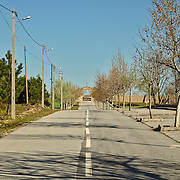 Road leading to cemetery in a rural area in central Portugal, close to the border to Spain