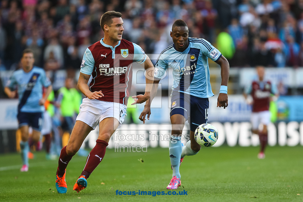 Jason Shackell of Burnley and Diafra Sakho of West Ham United compete for the ball during the Barclays Premier League match at Turf Moor, Burnley<br /> Picture by Daniel Chesterton/Focus Images Ltd +44 7966 018899<br /> 18/10/2014