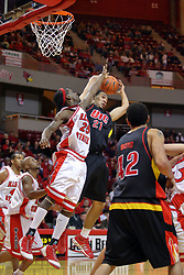 20 December 2008:  Champ Oguchi reaches for a rebound that Rob Eppinger has already grabbed during a game where the  Illinois State University Redbirds go to 11-0 on the season defeating the Flames of Illinois Chicago by a score of 67-60 on Doug Collins Court inside Redbird Arena on the campus of Illinois State University in Normal Illinois.
