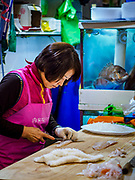 08 OCTOBER 2018 - SEOUL, SOUTH KOREA: A market vender prepares an order of sashimi in the Noryangjin Fish Market. The auctions start about 01.00 AM and last until 05.00 AM. Noryangjin Fish Market is the largest fish market in Seoul and has been in operation since 1927. It opened in the current location in 1971 and was renovated in 2015. The market serves both retail and wholesale customers and has become a tourist attraction in recent years.          PHOTO BY JACK KURTZ