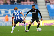 Brighton & Hove Albion winger Anthony Knockaert (11) takes on Wigan Athletic midfielder Shaun MacDonald (16) during the EFL Sky Bet Championship match between Wigan Athletic and Brighton and Hove Albion at the DW Stadium, Wigan, England on 22 October 2016.