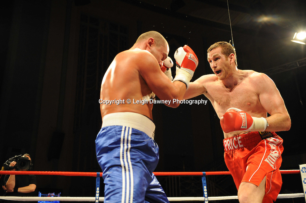 David Price (red shorts) defeats Raman Sukhaterin at The Troxy, Limehouse, London, 16th October 2010. Frank Maloney Promotions © Photo credit: Leigh Dawney