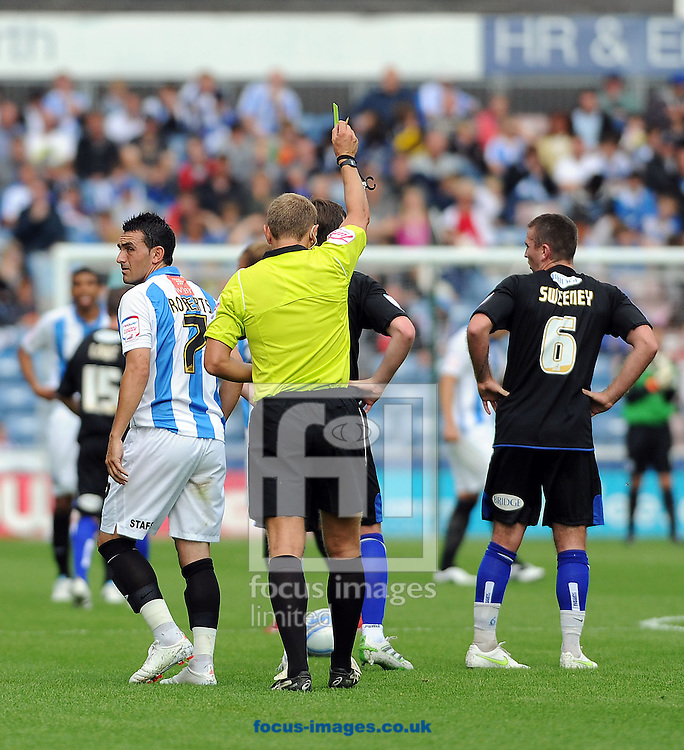 Picture by Graham Crowther/Focus Images Ltd. 07763140036.6/8/11.Gary Roberts of Huddersfield is booked duing the NPower League 1 game at The Galpharm Stadium Stadium, Huddersfield.