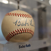 A baseball signed by Babe Ruth sits along side baseballs signed by Yankees players past and present inside the Yankee Museum at Yankee Stadium before the New York Yankees V Cincinnati Reds Baseball game at Yankee Stadium, The Bronx, New York. 19th May 2012. Photo Tim Clayton
