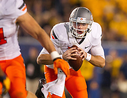 Oct 10, 2015; Morgantown, WV, USA; Oklahoma State Cowboys quarterback JW Walsh runs the ball during the second quarter against the West Virginia Mountaineers at Milan Puskar Stadium. Mandatory Credit: Ben Queen-USA TODAY Sports